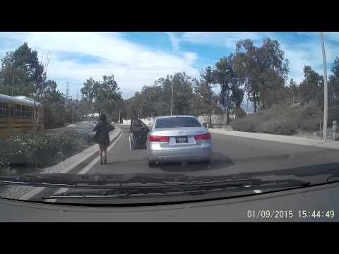 Woman Stops car, gets out and the car keeps going