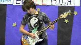 12-year-old plays AC/DC's Back In Black at talent show