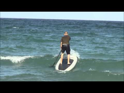 Surfing waves with 9′ SOT275 Saturn Inflatable Paddle Board.