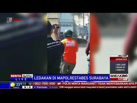 Seorang Anak Dibopong Polisi Saat Ledakan Bom di Mapolresta Surabaya