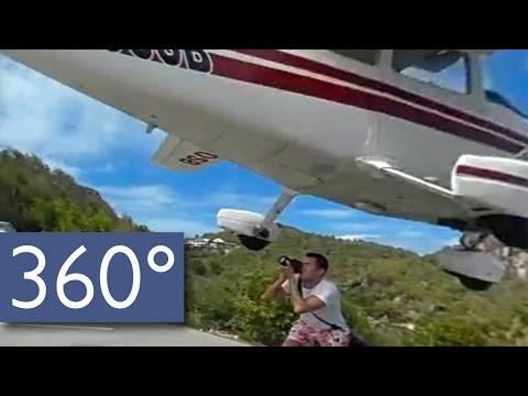 Video:  Plane nearly hits tourist.