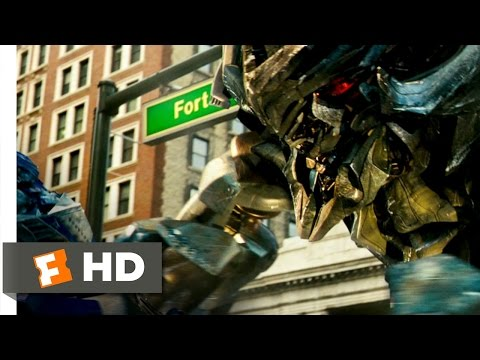 megatron - Transformers Movie Clip - watch all clips http://j.mp/wR83Yd click to subscribe http://j.mp/sNDUs5 Optimus Prime (Peter Cullen) and Megatron (Hugo Weaving) f...