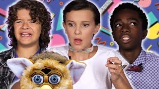 "The Cast of ""Stranger Things"" Review Retro Toys"
