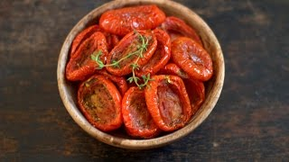 Subscribe for free click here http://bit.ly/1SkwdvHSlow dried tomatoes seasoned with herbs, salt & pepper in aromatic extra virgin olive oil. Great for snacking straight from the jar or for use in your salads, relishes, sandwiches, pizza and pasta. So easy to make, you must try these!IngredientsPlum tomatoes, ripe but firm - 1 kilogram Olive oil or any flavorless oil - 1/4 cupSalt to taste(easy here!)Grated fresh garlic - 1 teaspoon ( 5-6 pods)Dried thyme - 1 teaspoonFreshly ground black pepper - 1 teaspoonRed chilli flakes - 1 teaspoonAbout 3/4 cup more oil if you wish to preserve them in oil.Watch more of Know your Baking Ingredients - http://bit.ly/1NnBW3UMore easy recipes : http://bit.ly/1RMjscoBaking How To's - http://bit.ly/1PiuyXJ  How to choose an oven for baking, how to use a convection microwave, how to start baking,  how to use basic baking tools, basic ingredients, tips, techniques and simple recipes in this playlist Watch a new video every Monday! Connect with me for updates on new videos!Facebook : http://on.fb.me/1lCxpjpGoogle Plus : http://bit.ly/1Xj5Sz7Business inquiries: suma.rowjee@gmail.comBlog : http://www.cakesandmore.in/