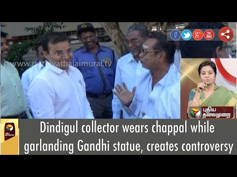 Dindigul-collector-wears-chappal-while-garlanding-Gandhi-statue-creates-controversy