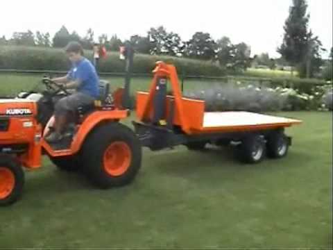 AJK - mini hooklift for gardenculture,horticulture and agriculture. Suitable for mini tractors from KUBOTA,ISEKI,NEW HOLLAND,JOHN DEERE,.... for info and sales see...