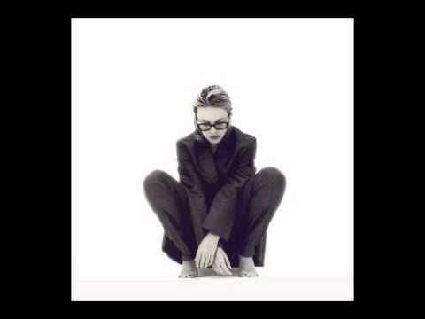Tekst piosenki Kylie Minogue - If I was your lover po polsku