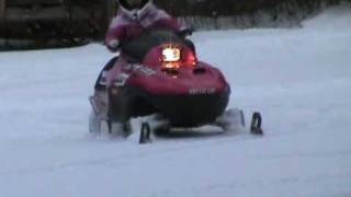 10. 4 year old snowmobiling Arctic cat 120 pink