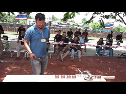 Guy Competing In Thailand Knife Cutting