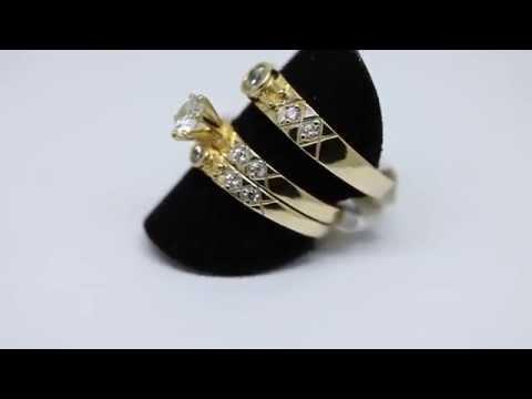 Trio de anillos de matrimonio en oro.
