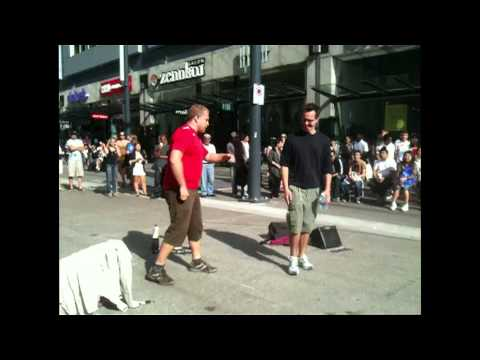 CRACK HEAD STARTS FIGHT WITH STREET PERFORMER ON GRANVILLE STREET VANCOUVER CANADA