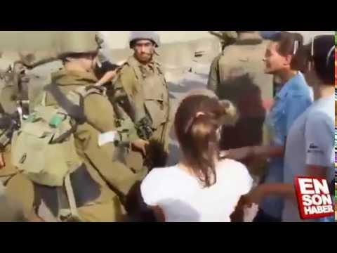 Video İsrail askerlerine kafa tutan Filistinli kız download in MP3, 3GP, MP4, WEBM, AVI, FLV January 2017