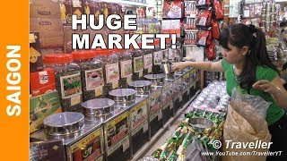 """This is a tour of the Ben Thanh Market locate in Ho Chi Minh City in District 1. When visiting the Vietnam city of Ho Chi Minh or Saigon as it is still known to many the Ben Thanh Market is one of Ho Chi Minh Cities top attractions to visit.This Ben Thanh Market Tour  is filmed with our 4K Camcorder which can be seen on Amazon here: http://amzn.to/2tyK6D9Ben Thanh Market Opening Hours:Monday 7AM–7PMTuesday 7AM–7PMWednesday 7AM–7PMThursday 7AM–7PMFriday 7AM–7PMSaturday 7AM–7PMSunday 7AM–7PMBen Thanh Market Address: Đường Lê Lợi, Bến Thành, Quận 1, Hồ Chí Minh, VietnamThe tour of this Ho Chi Minh City attraction  (Saigon City attraction) covers the entire market where the viewer is given a view of the non.food department where clothing, shoes, fabrics, leather goods, jewelry and some electronics such as watches are sold. Also included are the food sections from where everything from sweets, coffee, fruit, vegetables and alcohol containg a cobra and scorpion mix can be purchased. The videos ends with a nice tour of the Ben Thanh Food Court where the view can see some of the Vietnamese Street Food items that are available for sale in the Ben Thanh Market.Wiki writes about this Vietnam Market, """"Bến Thành Market (Vietnamese: Chợ Bến Thành) is a large marketplace in central Hồ Chí Minh City, Vietnam in District 1. The market is one of the earliest surviving structures in Saigon and an important symbol of Hồ Chí Minh City, popular with tourists seeking local handicrafts, textiles, áo dài and souvenirs, as well as local cuisine..."""" (Vietnamese Street Food.Wiki writes about Ho Chi Minh City, """"Ho Chi Minh City (Vietnamese: Thành phố Hồ Chí Minh) formerly named and still informally known as Saigon (Vietnamese: Sài Gòn; [sàj ɣɔ̀ŋ] ), is the largest city in Vietnam by population. It was once known as Prey Nokor (Khmer: ព្រៃនគរ) prior to annexation by the Vietnamese in the 17th century. Under the name Saigon, it was the capital of the French colony of Cochinchina and later of the """