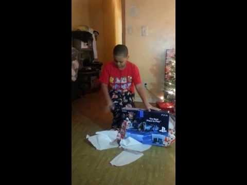 gift reaction funny - Lil boys holds his tears when he receives his PS4 for christmas. he had to regain his composure !!