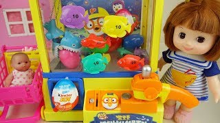 Baby doll and Fish crane machine surprise eggs toys play
