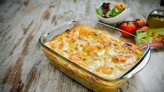 Ferva as lascas de bacalhau com o leite e o cubo Knorr de caldo de mariscos sobre lume brando durante cerca de 3 a 4 minutos.