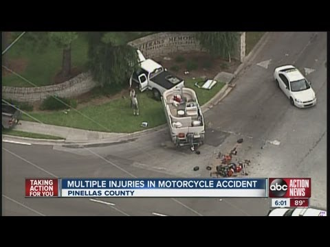 haul truck crash - A truck hauling a boat and a motorcycle crash on Bay Pines Boulevard in Pinellas County.