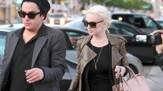 Saturday, January 21, 2012 - Lindsay Lohan wears a see-through black shirt and no bra while shopping at XIV Karats in Beverly...