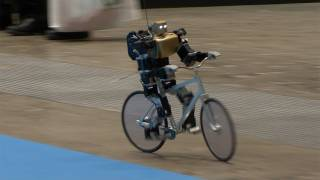 Amazing Bike Riding Robot! Can Cycle, Balance, Steer, and Correct Itself.