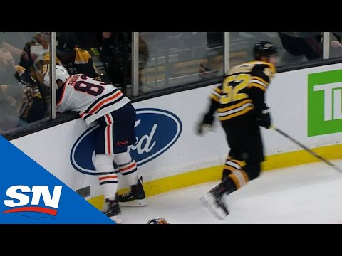 Glass Pops Out After Bruins' Sean Kuraly Hits Oilers' Matthew Benning Into Boards