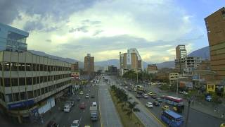 Busy junction watched from the metro station in Medellin, Columbia - Timelapse