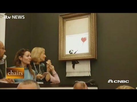 Banksy painting self shreds after being sold