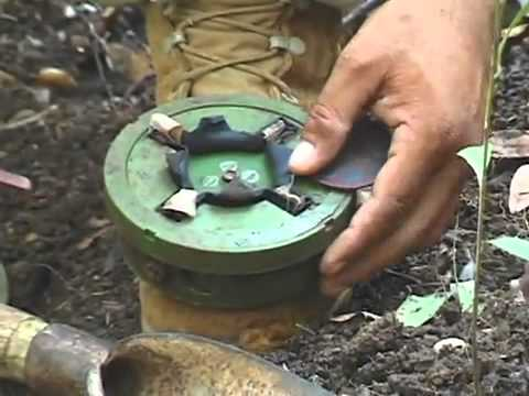 Cambodian shows how to disarm a 50 year old mine, then demonstrates a detonation