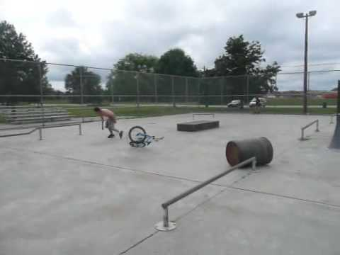 Guy bunnyhopping over barrel at Martin skatepark in Elkhart