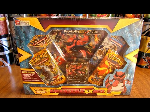 box - A Krookodile EX Box is opened in this video. This box includes a Krookodile EX foil promo card, an oversized Krookodile EX card, an online TCG code card and 4 Pokemon booster packs, 2 each...