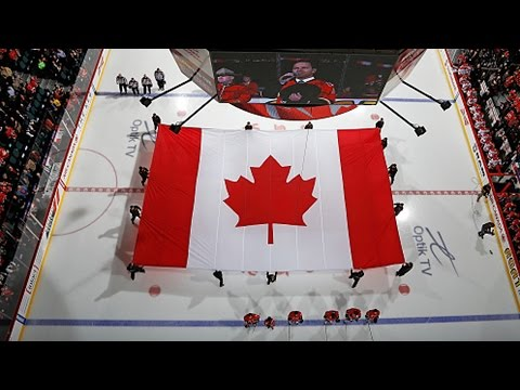 events - The Calgary Flames take a moment of silence and pay tribute to the tragedy in Ottawa prior to their game against the Carolina Hurricanes on 10/23/14.