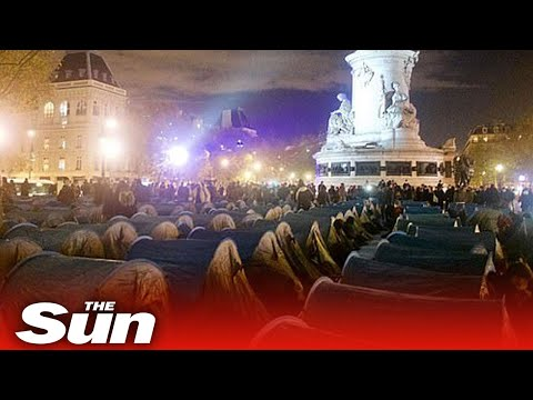 Paris police tear down refugee camp & tear gas hundreds