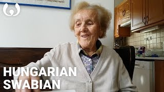 This video was recorded by Mária's grandson Márton Tóth in Perbál, Hungary, where she lives. She is a member of the Danube Swabian community, descendants of German-speaking peoples who settled southeastern Europe between the 17th and 18th centuries. Her native language, Swabian, known locally as 'Sváb', is spoken by over 800,000 people, principally in the Swabia region of southwestern Germany, as well as in parts of Hungary and Romania; it remains politically unrecognized by all three governments. A Germanic language, it is closely related to German, Bavarian, and Dutch, among others. Mária's other primary language, Hungarian, is spoken by as many as 13 million people worldwide.Help us caption & translate this video!http://amara.org/v/89Dr/
