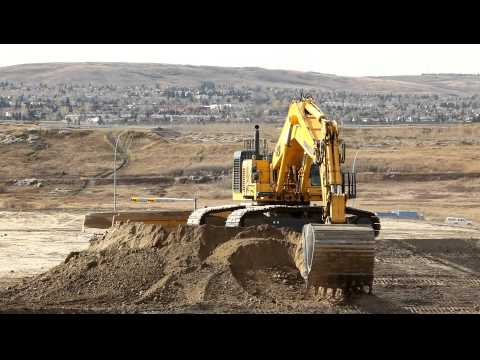 komatsu - Someone in a nice shiny Komatsu 1250 loading trucks like a girl. At 4:04 you see the obligatory Komatsu mechanic reassuring the 1250 that it's ok so it doesn...