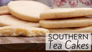 """❤️ SUBSCRIBE: http://bit.ly/divascancookfan   If you grew up in the South chances are you had a """" tea cake lady"""" or an """" icee lady"""" on your street!  I had both and I still remember those old fashioned Southern tea cakes like it was yesterday. What a nostalgic treat! I can never find when & where these little """"cakes"""" originated from but they are one of those super old recipes that require only a few ingredients which made them really affordable back in the day. Some folks say they were called Great Depression cookies but they date back waaaaaay further than that!Now depending on where you're from in the South determines how you like your tea cakes usually, or at least what you consider to be """"an authentic tea cake"""" .  Some like them crunchy and plain, others like them drizzled in glaze and some like them just like this recipe: fluffy & tender in the middle, chewy around the edges with golden, barely crisp bottoms.Tea cakes are like the love child of a cake, cookie, and biscuit, yet they taste like sweet, flavorful cornbread or pound cake with faint flavors of nutmeg and vanilla. Now though, it seems like tea cakes are almost a forgotten recipe. Other bolder tea treats have taken their place, which is a shame! They aren't gonna knock your socks off or anything but they are simple,  easy, plain and unique in their own way…and something about that makes them extra special. Pile them up on a plate, put on some tea,  invite your girls over and chat the afternoon away!!GET RECIPE: http://divascancook.com/old-fashioned-tea-cakes-recipe-authentic-southern/___________________________________________________________________🍕🍔🍰FAN FAVORITED RECIPES:🍦🍩🍟How To Make Cake Pops: https://youtu.be/9BcBK2_nKmAHow To Make Baked Mac n Cheese: https://youtu.be/e8S1vFC8zYkHow To Make Crispy Fried Chicken: https://youtu.be/JXCmp1jMi0w--------------------------------------------------------------------------------------------🤗FOLLOW ME ON SOCIAL MEDIA! 👠😘OFFICIAL WEBSITE: http://divascancook"""
