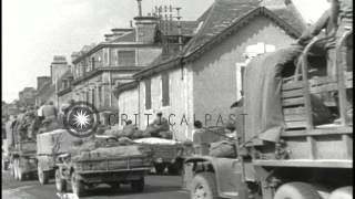Alencon France  city pictures gallery : Vehicles of the 90th Infantry Division move on road in Alencon, France. HD Stock Footage