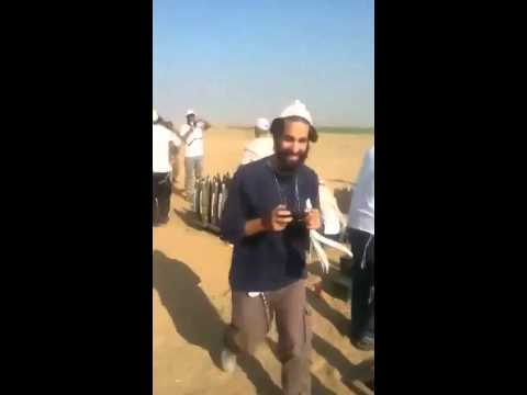 Israeli soldiers and members of the Breslauer Hassidic sect dance and bless artillery shells