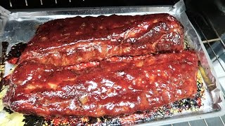 Easy BBQ Baby Back Rib Recipe. Pork Ribs. Oven roasted pork ribs cooking video. Sweet and sticky bbq ribs, super easy, feed...