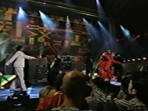 award shows - The Fugees rock the crowd at some award show. Nas steps out for a guest appearance looking like the Syracuse orangeman mascot.