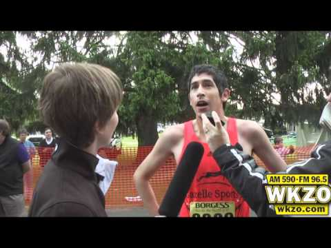Carolyn Binder talks with the 2012 Kalamazoo Marathon 5k winners Kyle Mena and Chelsea Fuller