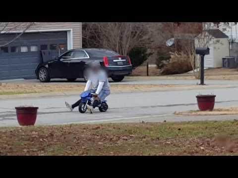 Giant Man Test Drives Mini Bike