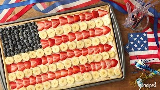 """Get the recipe for Patriotic Fruit Pizza at: http://allrecipes.com/recipe/218358/patriotic-fruit-pizza/ Your 4th of July picnic is complete with this impressive patriotic-themed fruit pizza boasting a sugar cookie crust, cream cheese """"sauce"""" and fresh fruit toppings. Flour, vegetable shortening, margarine, sugar, eggs and vanilla make the tempting crust to carry the filling of cream cheese, sugar and vanilla. Decorate in alternating stripes of fresh strawberries, bananas dipped in lemon juice, and a corner of blueberries, then slice and serve an Independence Day celebration!Subscribe to Allrecipes @ http://www.youtube.com/subscription_center?add_user=allrecipesAllrecipes Magazine is now available!U.S. subscribers, subscribe here: http://armagazine.com/subscribenowCanadian subscribers, subscribe here: http://themeredithstore.ca/p-282-allrecipes-subscription.aspxFacebookhttp://www.facebook.com/AllrecipesTwitter @Allrecipes"""