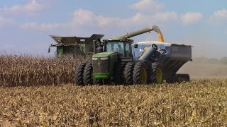 Big John Deere Machines Harvesting Corn