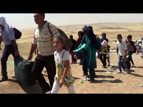 Hungry and scared, Syrian refugees flood Iraq