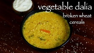 full recipe: http://hebbarskitchen.com/daliya-khicdi-recipe-broken-wheat-recipe/download android app: https://play.google.com/store/apps/details?id=com.hebbarskitchen.android&hl=endownload iOS app: https://itunes.apple.com/us/app/id1176001245Email – hebbars.kitchen@gmail.comWebsite – http://hebbarskitchen.com/Facebook – https://www.facebook.com/HebbarsKitchenTwitter – https://twitter.com/HebbarsKitchenPinterest – https://www.pinterest.com/hebbarskitchen/plus one – https://plus.google.com/103607661742528324418/postslinkedin - https://in.linkedin.com/in/hebbars-kitchen-b80a8010ainstagram - https://www.instagram.com/hebbars.kitchen/tumblr - http://hebbarskitchen.tumblr.com/twitter - https://twitter.com/HebbarsKitchenMusic:https://soundcloud.com/del-sounddaliya recipe  vegetable dalia khichdi recipe  broken wheat recipe with detailed photo and video recipe. basically a cereal food prepared from the hulled or crushed grain of various different wheat varieties in which most common one is durum wheat. it is mainly served to kids or often termed as kids recipe which can also be served to adults as weight loss recipe.daliya recipe  vegetable dalia khichdi recipe  broken wheat recipe with step by step photo and video recipe. there are several recipes prepared from broken wheat which includes soup, bread, pilafs or pulav and even khichdi from the indian cuisine. broken wheat recipes are mainly found in the mediterranean cuisine and middle eastern cuisine, however lately it has gained lot popularity in indian cuisine too. this post describes the basic indian style khichdi recipe of daliya with moong dal and some spices.