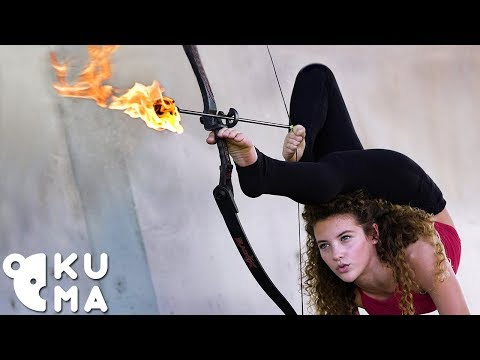 Amazing Hand Balancer Shoots a Flaming Arrow Using Her
