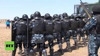 Video ID: 20140801-034 ¤W/S Riot police rushing to enter a building behind BTR-80 ¤W/S Riot police storming building ¤M/S...