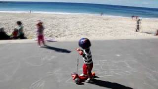 baby riding scooter