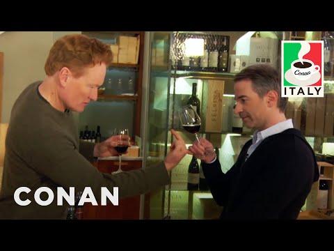 Jordan Schlansky from Conan breaking his insufferable character while wine tasting