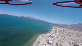 Flying my Phantom 1.1.1 over Camp Daggetts in the samll Baja twon of Bahia De Los Angeles. Unfortunately my Gimbal broke on the drive down, so the video is ...