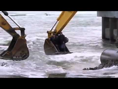 Crazy Russians crossing the river with excavators